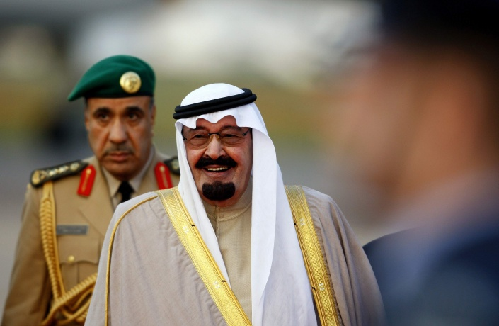 Saudi Arabia's King Abdullah (R) arrives at Heathrow Airport in west London, in this October 29, 2007 file photo. REUTERS/Dylan Martinez