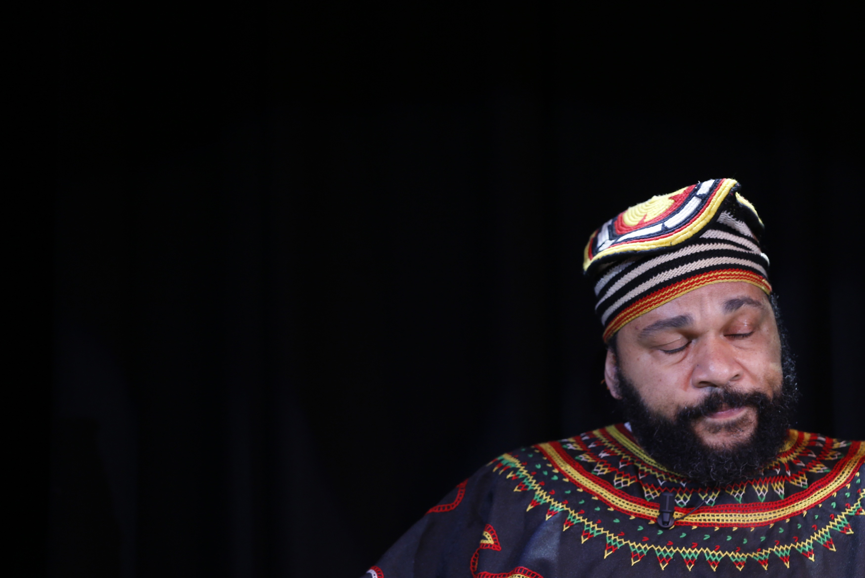 "PHOTO CAPTION: French comedian Dieudonne M'Bala M'Bala, also known as just ""Dieudonne"", as he attends a news conference at the ""Theatre de la Main d'or"" in Paris January 11, 2014.  Photo Credit: Reuters / Gonzalo Fuentes"