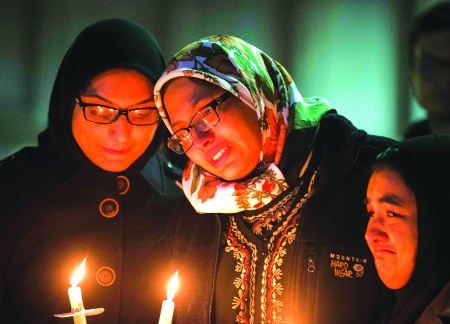REUTERS/Chris Keane Students attend a vigil on the campus of the University of North Carolina, for Deah Shaddy Barakat, his wife Yusor Mohammad and Yusor's sister Razan Mohammad Abu-Salha.