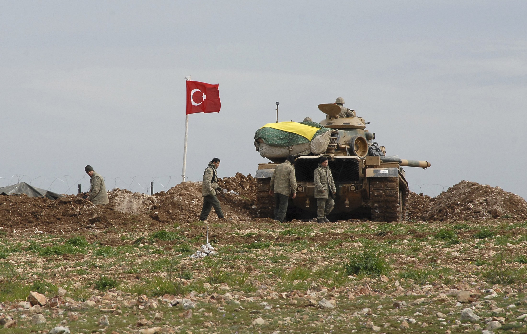 Turkish soldiers and an army tank take position at the new site of the Suleyman Shah tomb near the northwern Syrian village of Esme, on the Syrian-Turkish border February 24, 2015. Photo credit: Reuters.