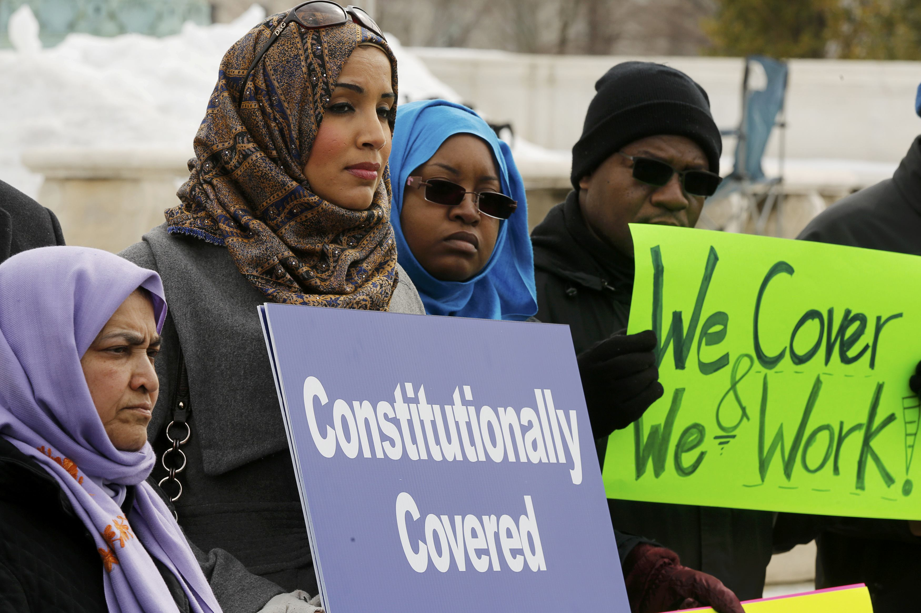 Demonstrators gather outside the U.S. Supreme Court as the court hears arguments in the case of Muslim woman Samantha Elauf. Photo credit: Jim Bourg / Reuters.