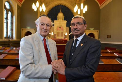 PHOTO CAPTION: Synagogue council chairman Rudi Leavor (left) with Jani Rashid.