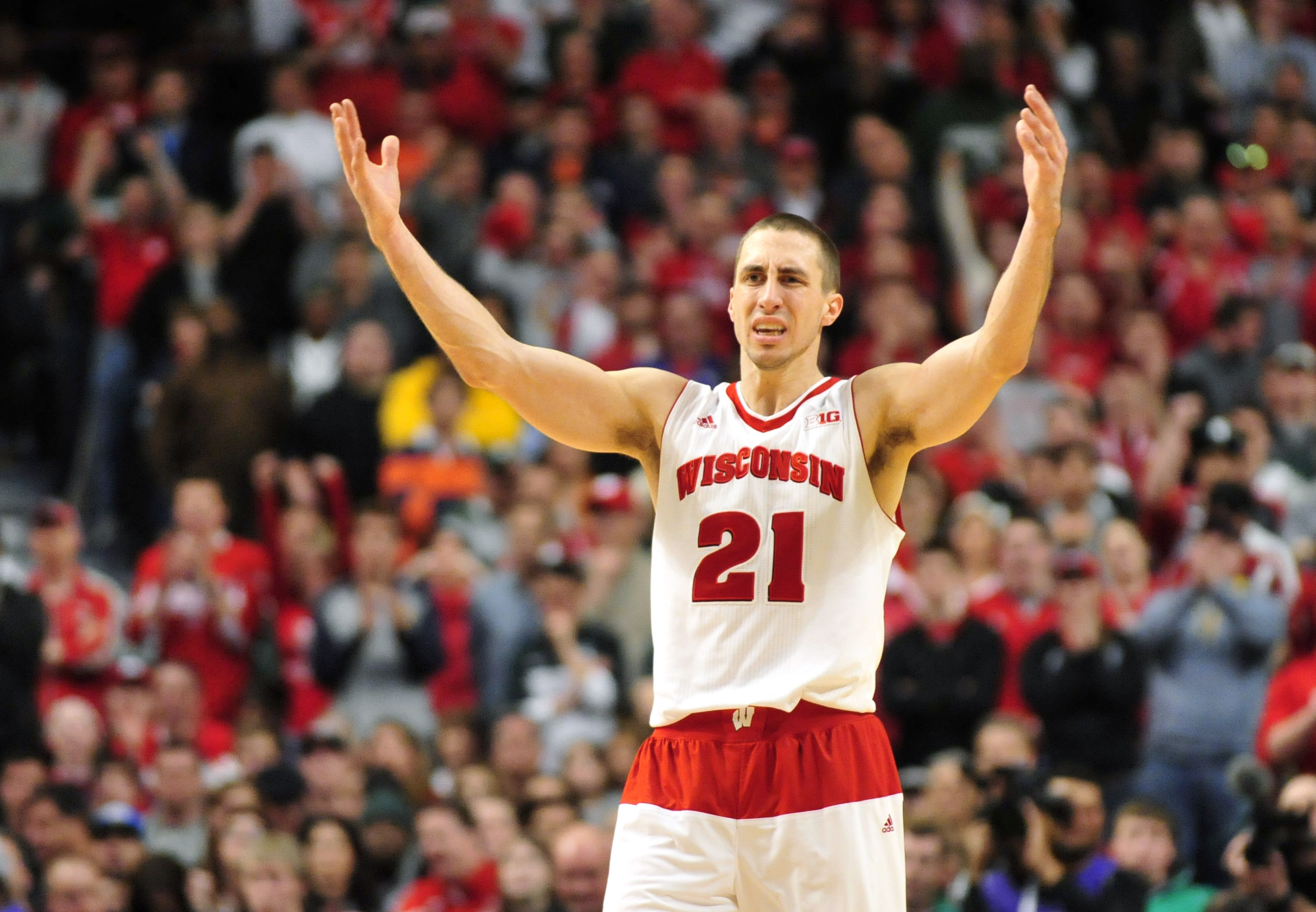 Wisconsin Badgers guard Josh Gasser reacts during overtime in the championship game of the Big Ten tournament against the Michigan State Spartans at the United Center. Photo credit: David Banks / USA Today Sports.
