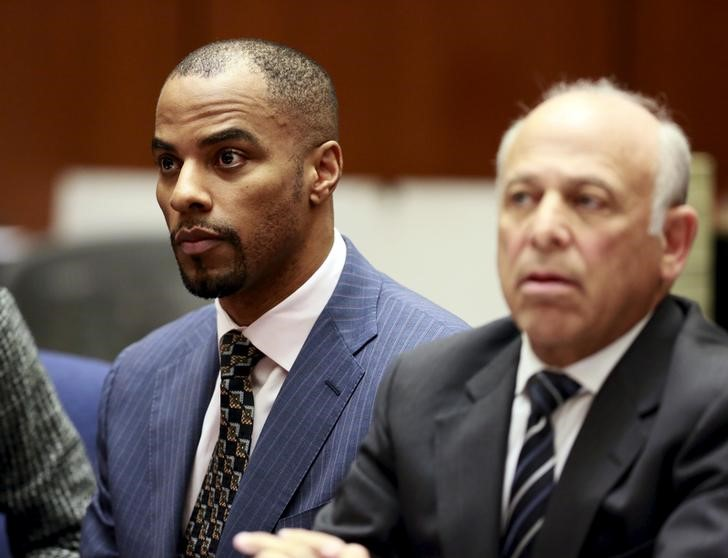 Former NFL star Darren Sharper (left) and his attorney Leonard Levine appear at the Clara Shortridge Foltz Criminal Justice Center in Los Angeles, March 23. Photo credit: Nick Ut / Reuters.