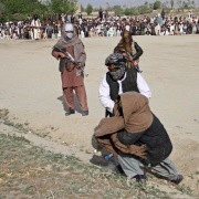 A member of the Taliban brings one of three men accused of murdering a couple during a robbery, before their execution in Ghazni Province April 18, 2015. Stringer/Reuters