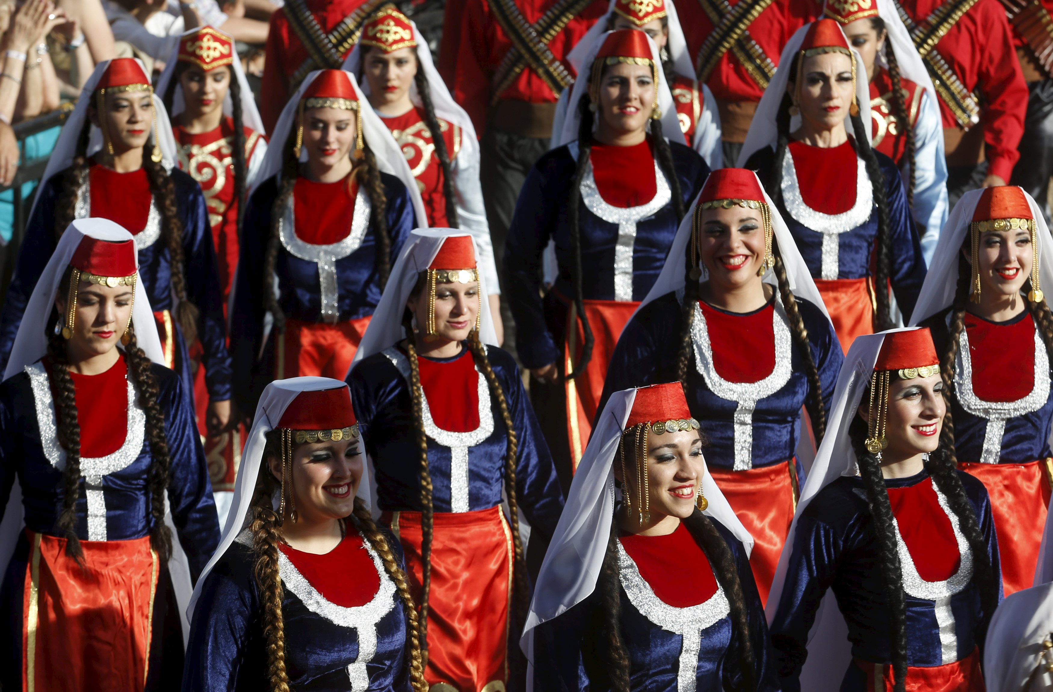 Members of the Armenian community in Argentina in cultural costume parade in Buenos Aires during a commemoration marking the 100th anniversary of the mass killing of Armenians by Ottoman Turks, April 25. Enrique Marcarian / Reuters.