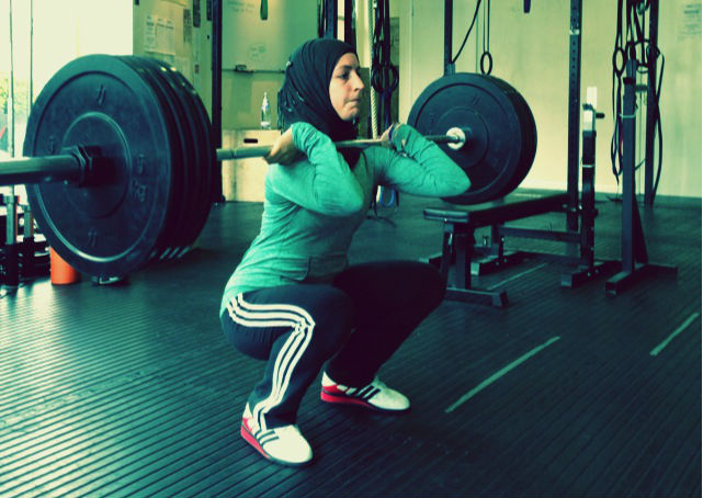 Irfan_GYM 9_Zainab Ismail performs squats cropped