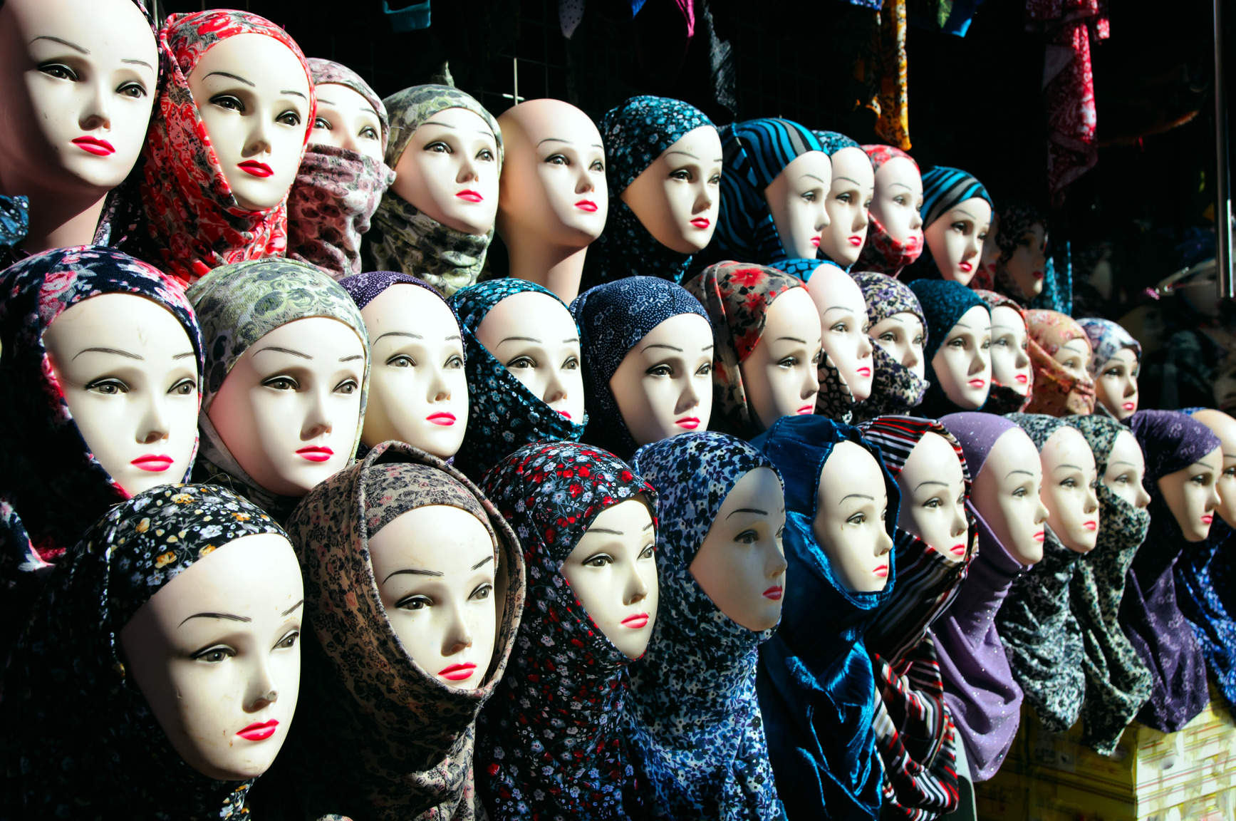 Closeup of mannequin heads in hijab.  Photo credit:  Photodune.