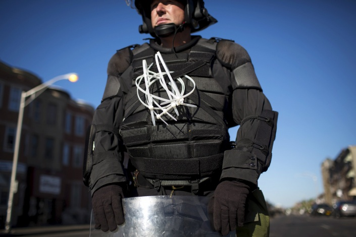 A Maryland state police trooper stands guard in Baltimore, April 28. Eric Thaye / Reuters.