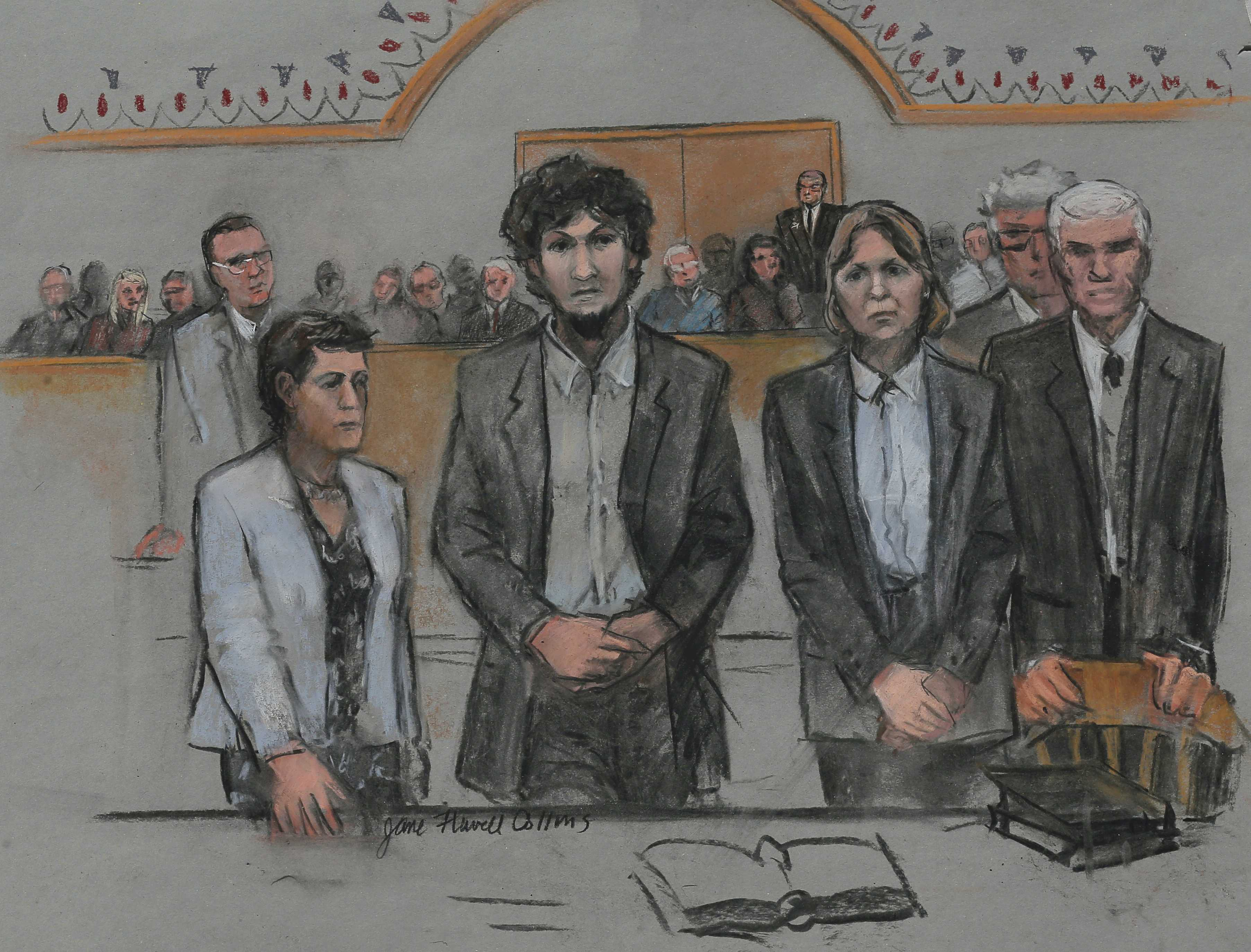 Dzhokhar Tsarnaev and his defense attorney Judy Clarke (2nd from right) are shown in a sketch after sentencing at the federal courthouse in Boston, May 15. Jane Flavell Collins / Reuters.