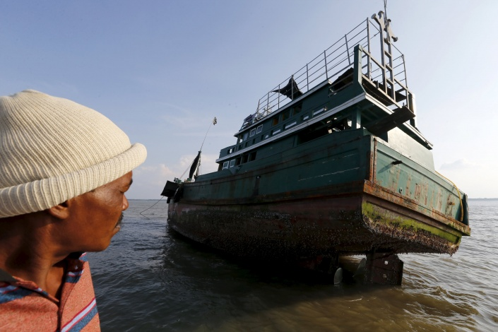 An abandoned boat which carried Rohingya and Bangladeshi migrants from Thailand is found off the coast near the city of Kuta Binje