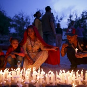 Nepalis take part in a candlelight vigil, a month after the April 25 earthquake in Kathmandu, Nepal May 25, 2015. Navesh Chitrakar / Reuters