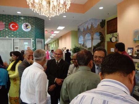 People socializing at the GMAA event, left to right, Dr. AS Nakadar, Mr. Latif Vora (back to camera), Usman Baki, Ajmeri, G. Rasool Mansuri, and others.