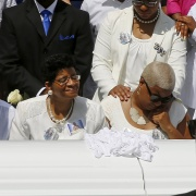 Shante Needham and Sharon Cooper, sisters of Sandra Bland, and Bland's mother Geneva Reed-Veal attend the funeral in the Chicago suburb of Willow Springs