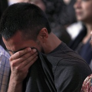 A man from the Islamic Center, who did not wish to be identified, begins to cry during an interfaith vigil at Olivet Baptist church in Chattanooga, Tennessee July 17. Tami Chappell / Reuters