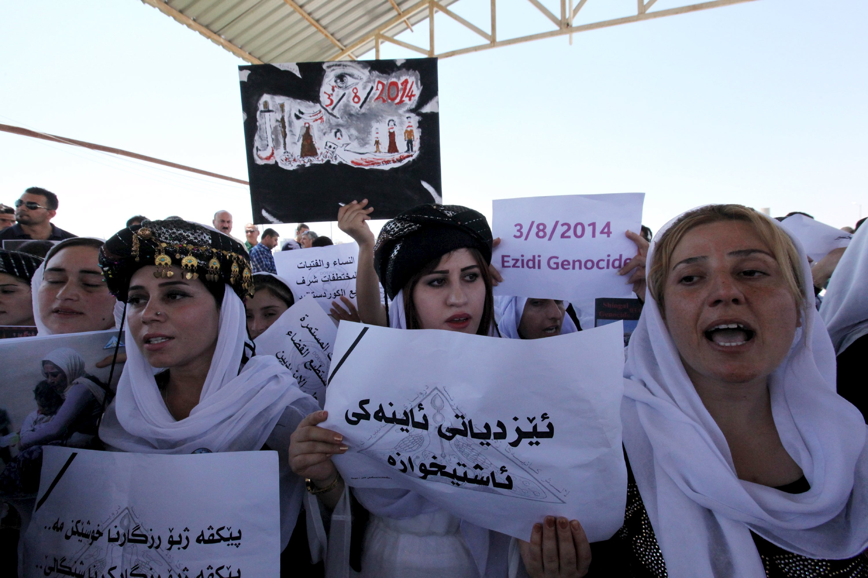 Displaced female demonstrators from the minority Yazidi sect gather during a protest outside the headquarters of the U.N. Mission in Iraq, August 2. Azad Lashkari / Reuters.
