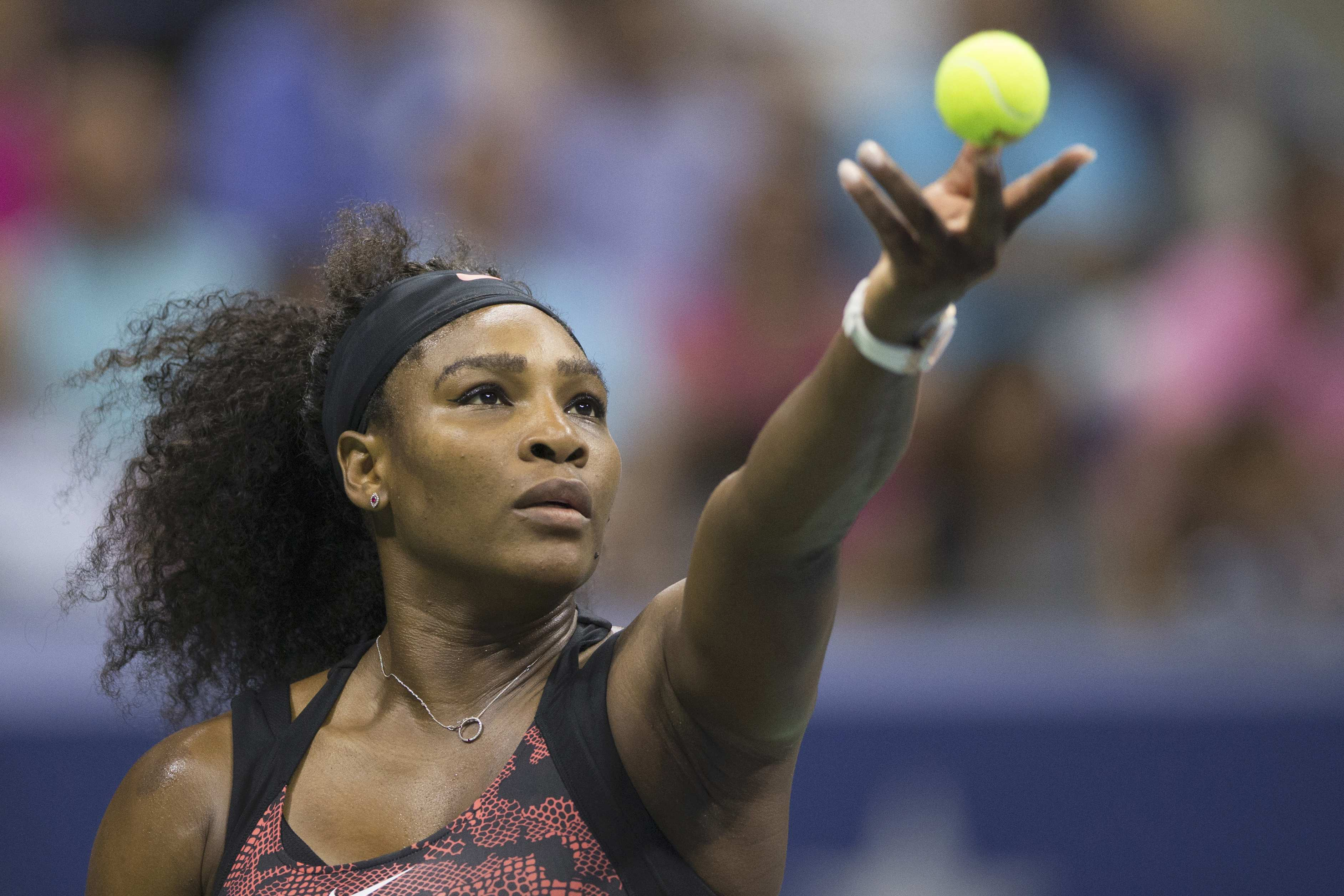 Serena Williams of the U.S serves to her sister and compatriot Venus Williams during their quarterfinals match at the U.S. Open, Sept 8. Carlo Allegri / Reuters.