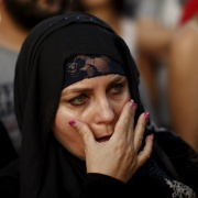 A woman reacts as she takes part in a protest in solidarity with the refugees from Syria, in Malaga, September 9. Jon Nazca / Reuters