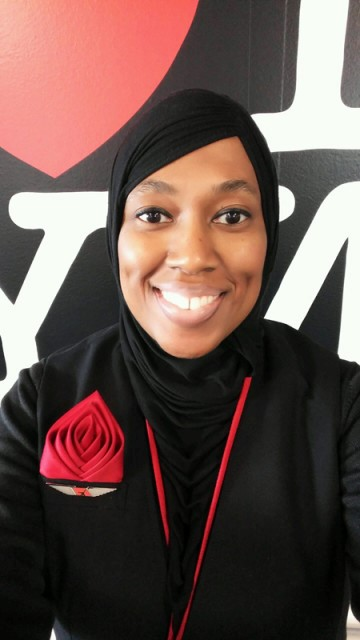 Charee Stanley, a Muslim flight attendant, says ExpressJet suspended her for refusing to serve alcohol. Photo courtesy of CAIR-Michigan, via USA Today