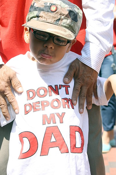 Michael Claros, 5, joined hundreds of faith leaders and immigration activists at a protest in front of the White House on July 31, 2014. RNS photo by Heather Adams
