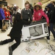 "Shoppers wrestle over a television as they compete to purchase retail items on ""Black Friday"" at an Asda superstore in Wembley, north London November 28, 2014. Supermarket Asda, the British arm of Wal-Mart, said it will not participate in this year's Black Friday shopping frenzy, a year after brawls at one of its stores characterised the arrival of the U.S. import to Britain. Luke MacGregor / Reuters"