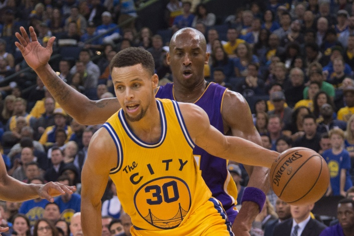 Golden State Warriors guard Stephen Curry (30) dribbles the basketball against Los Angeles Lakers forward Kobe Bryant (24) during the third quarter at Oracle Arena. The Warriors defeated the Lakers 111-77. Kyle Terada-USA TODAY Sports