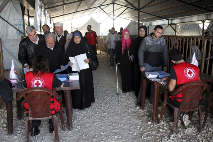 Syrian refugees line up to receive aid for the winter from the U.N. refugee agency in Tripoli, northern Lebanon, on Nov. 18, 2015. Photo courtesy of Omar Ibrahim / Reuters