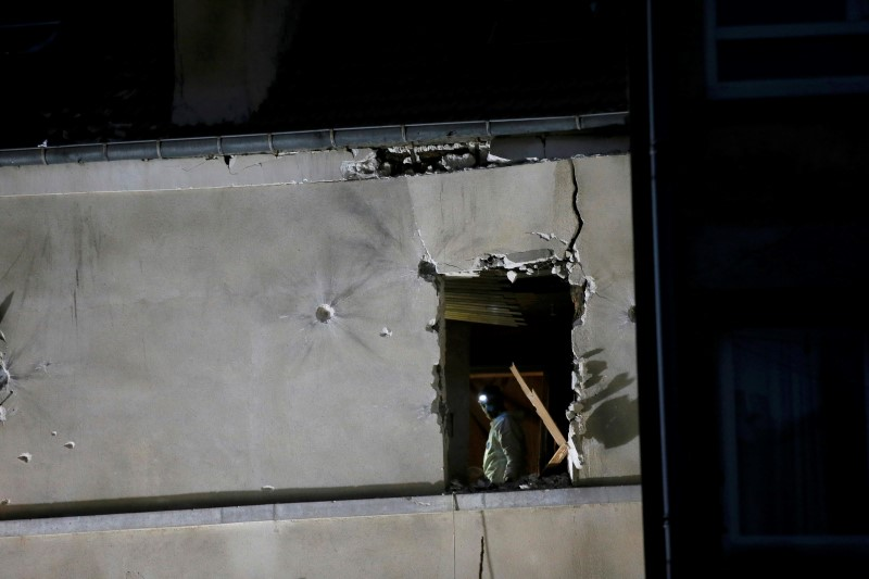 A forensic expert inspects the apartment raided by French Police special forces earlier in Saint-Denis, near Paris, France, November 18, 2015 during an operation to catch fugitives from Friday night's deadly attacks in the French capital. Gonzalo Fuentes / Reuters
