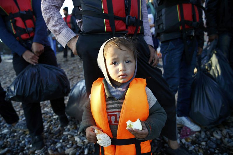 Refugees wait to get on a dinghy to sail off for the Greek island of Chios from the western Turkish coastal town of Cesme, in Izmir province, Turkey, November 4, 2015. Umit Bektas / Reuters