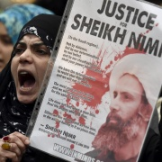 A protester holds a placard during a demonstration against the execution of Shi'ite cleric Sheikh Nimr al-Nimr in Saudi Arabia, outside the Saudi Arabian Embassy in London, Britain, January 3, 2016. Toby Melville/Reuters