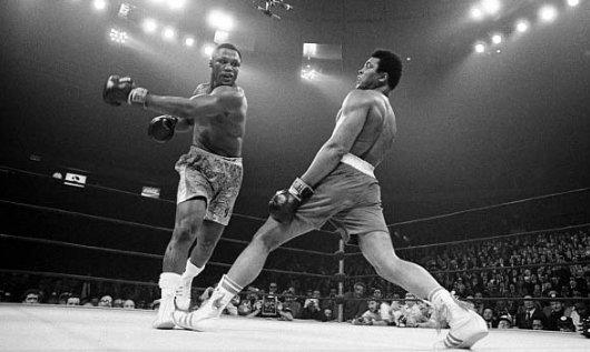 """Muhammad Ali dodges a punch from Joe Frazier at the """"Fight of the Century""""March 8, 1971. / photo courtesy https://www.flickr.com/photos/summer1978/"""